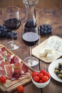 sliced prosciutto with red wine and olives